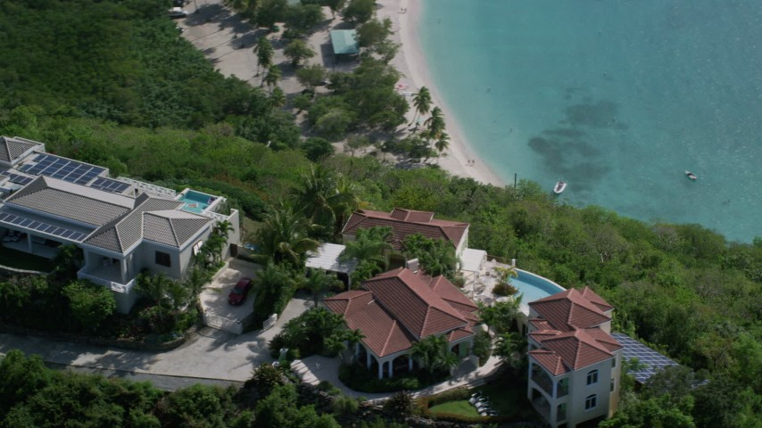 5k aerial video of Hilltop mansions overlooking turquoise blue Caribbean waters, Magens Bay, St Thomas  Aerial Stock Footage | AX102_288