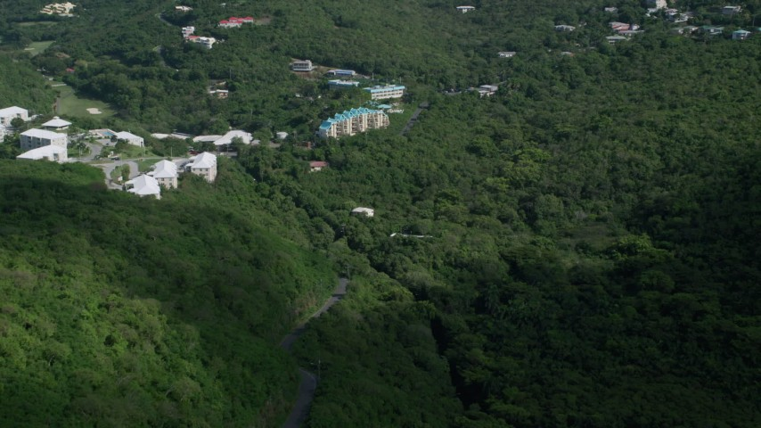 5k stock footage aerial video of Condominiums on a hillside surrounded by trees, Northside, St Thomas  Aerial Stock Footage | AX102_289