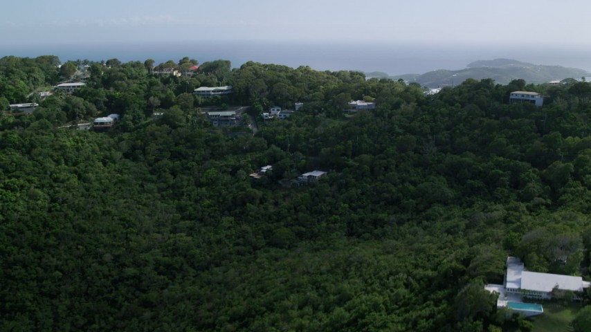 Hilltop oceanfront homes reveal Caribbean blue waters, Northside, Charlotte Amalie Aerial Stock Footage | AX102_291