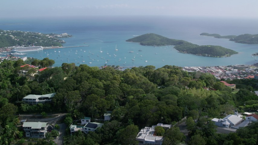 Reveal coastal town along turquoise blue Caribbean waters, Charlotte Amalie, St Thomas  Aerial Stock Footage AX102_292