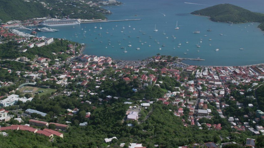 5k stock footage aerial video of a Coastal town along turquoise blue Caribbean waters, Charlotte Amalie, St Thomas  Aerial Stock Footage | AX102_293