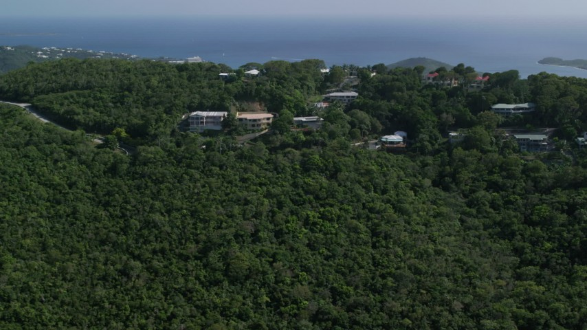 5k stock footage aerial video of Hilltop Caribbean homes among trees, Northside, St Thomas Aerial Stock Footage AX102_294