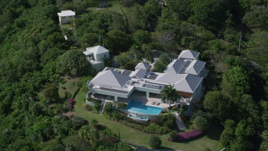 Mansion nestled among trees, Charlotte Amalie, St Thomas  Aerial Stock Footage | AX102_298