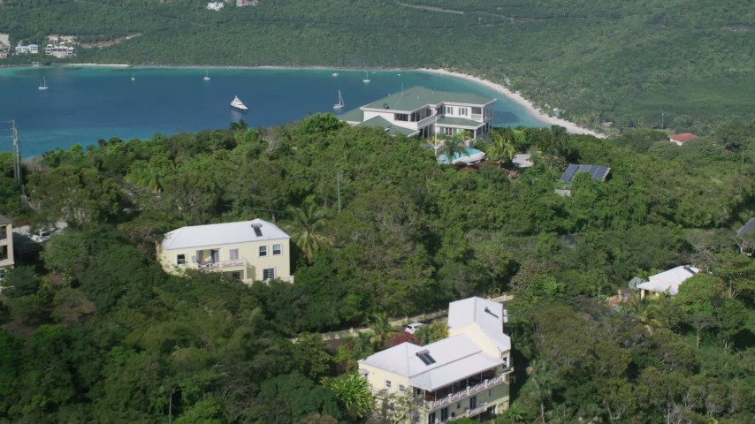 5k stock footage aerial video of Hilltop mansions and Caribbean waters, Magens Bay, St Thomas  Aerial Stock Footage | AX102_299