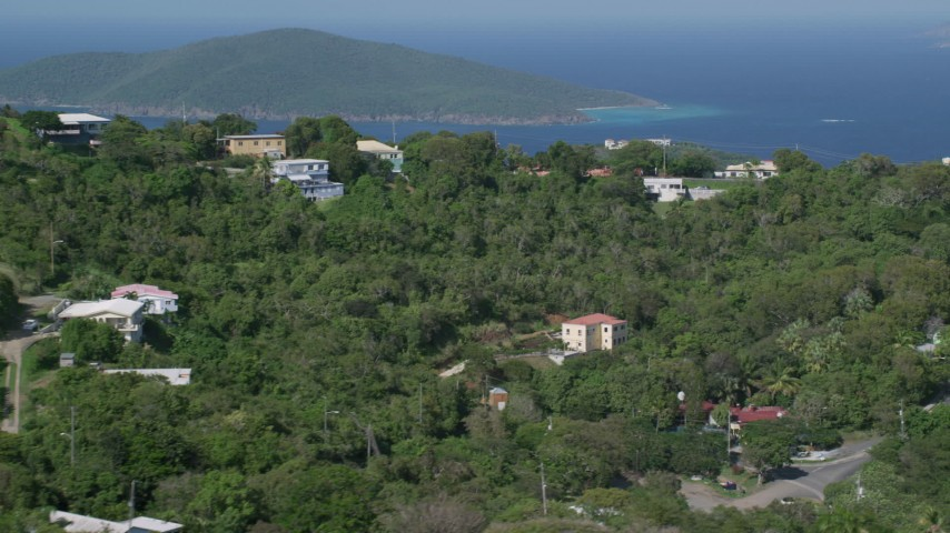 5k stock footage aerial video of Hilltop mansions looking out at Caribbean blue waters, Charlotte Amalie, St Thomas Aerial Stock Footage | AX102_300
