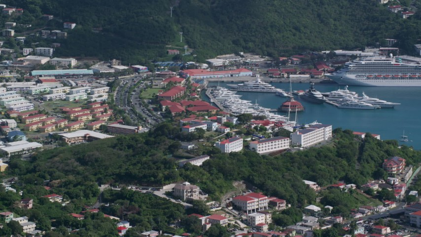 Coastal town, cruise ship and yachts in Caribbean blue waters, Charlotte Amalie, St Thomas Aerial Stock Footage | AX102_302
