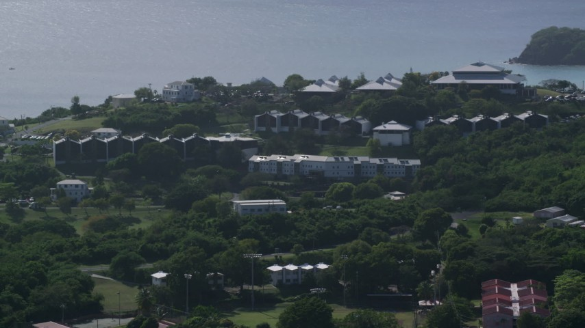 University of the Virgin Islands with a view of Caribbean waters, St Thomas Aerial Stock Footage | AX102_305