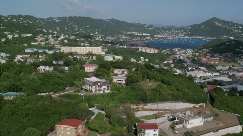 5k aerial video Flying over homes in hills of coastal town, Charlotte Amalie, St Thomas Aerial Stock Footage | AX103_002