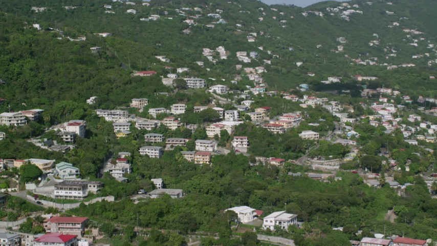 Upscale hillside homes among trees, Charlotte Amalie, St Thomas Aerial Stock Footage | AX103_003