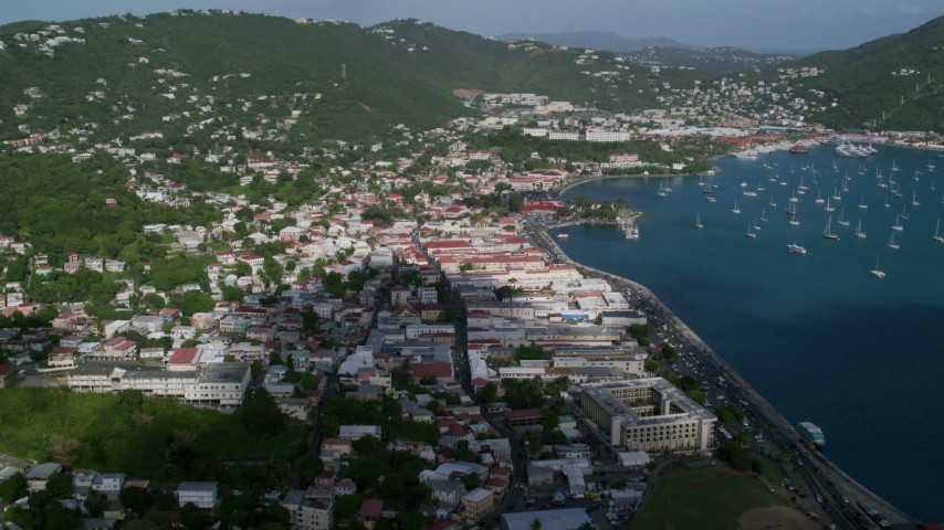 Coastal town along Caribbean blue waters, Charlotte Amalie, St Thomas Aerial Stock Footage | AX103_004