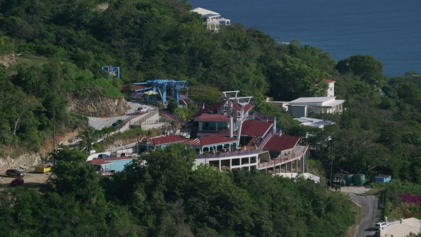 Paradise Point Tramway overlooking Caribbean blue waters, Charlotte Amalie Aerial Stock Footage | AX103_007