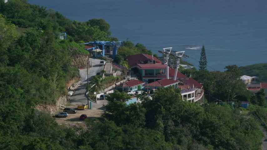 Paradise Point Tramway looking toward the ocean, Charlotte Amalie Aerial Stock Footage | AX103_008