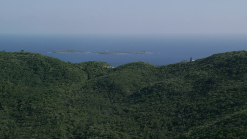 5k stock footage aerial video of Tree covered hills above blue Caribbean waters, Southside, St Thomas Aerial Stock Footage | AX103_009
