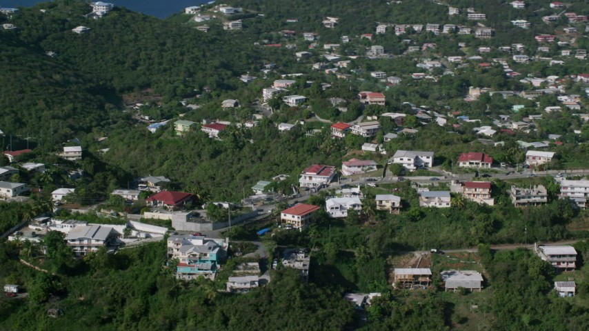 5k stock footage aerial video of Homes among tree covered hills, East End, St Thomas Aerial Stock Footage | AX103_012