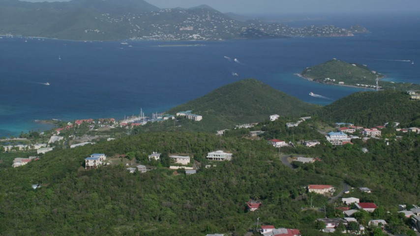 5k stock footage aerial video Caribbean resorts along sapphire blue waters, East End, St Thomas Aerial Stock Footage | AX103_013