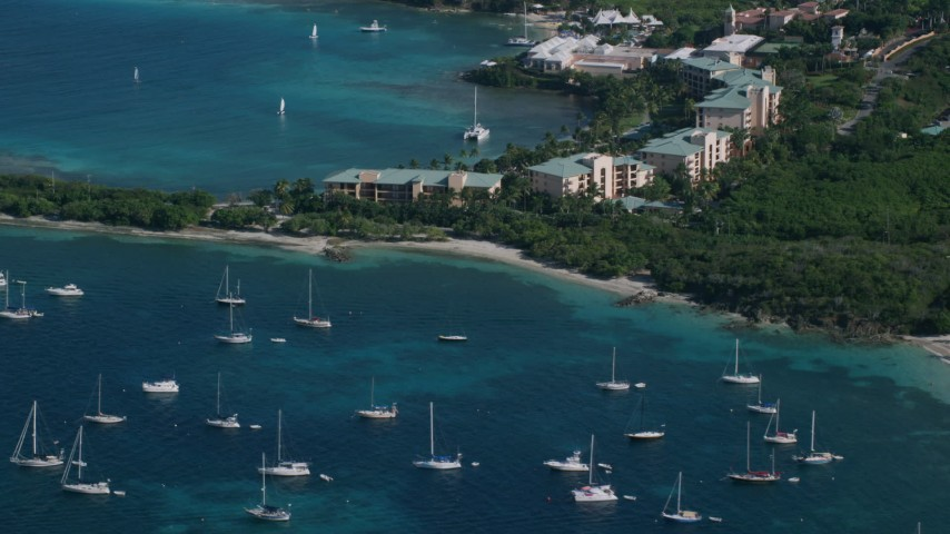 5k stock footage aerial video of The Ritz-Carlton and turquoise blue Caribbean waters, St Thomas Aerial Stock Footage | AX103_015