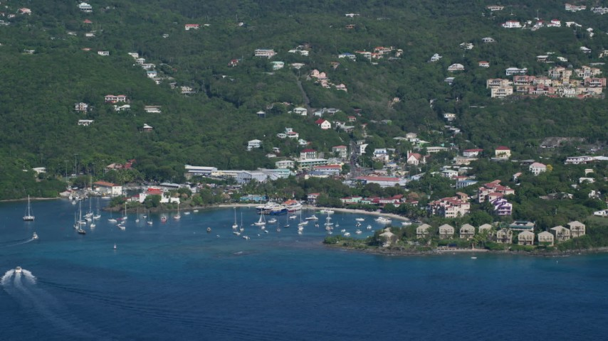 5k stock footage aerial video of a Coastal town and hillside homes along Caribbean blue waters, Cruz Bay, St John Aerial Stock Footage   AX103_017