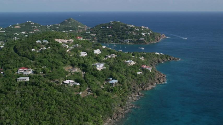 5k stock footage aerial video of Hillside homes overlooking sapphire blue ocean waters, Cruz Bay, St John Aerial Stock Footage   AX103_020