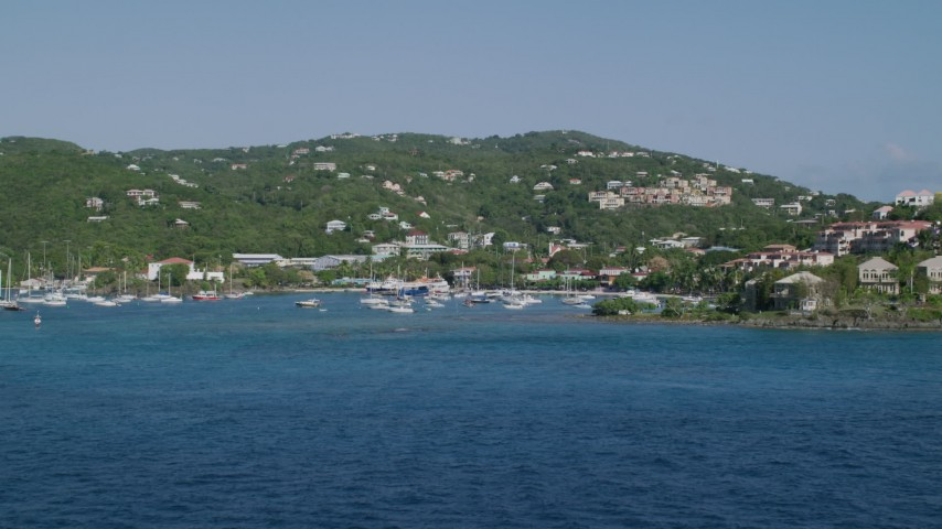 5k stock footage aerial video of the Blue Caribbean waters in the harbor and hillside homes, Cruz Bay, St John Aerial Stock Footage | AX103_029