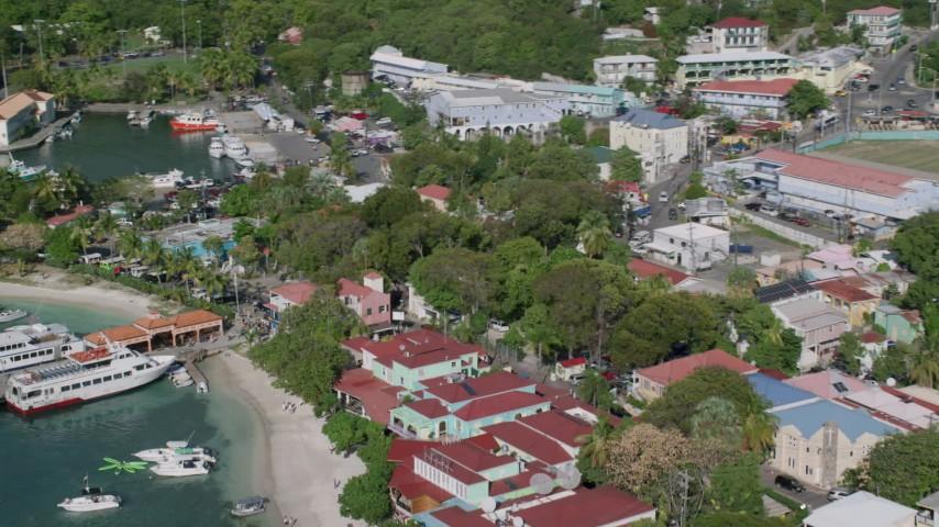 5k aerial video of Waterfront Caribbean shops, Cruz Bay, St John Aerial Stock Footage | AX103_031