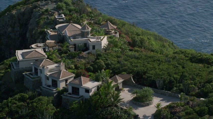 5k stock footage aerial video of a Hilltop mansion with a Caribbean blue ocean view, Cruz Bay, St John Aerial Stock Footage | AX103_039