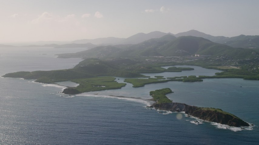 5k aerial video of Tiny islands in sapphire blue Caribbean waters off the coast, East End, St Thomas Aerial Stock Footage | AX103_064