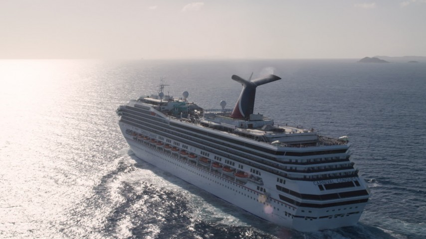 5k stock footage aerial video of Carnival cruise ship in Caribbean blue waters, St Thomas Aerial Stock Footage | AX103_073