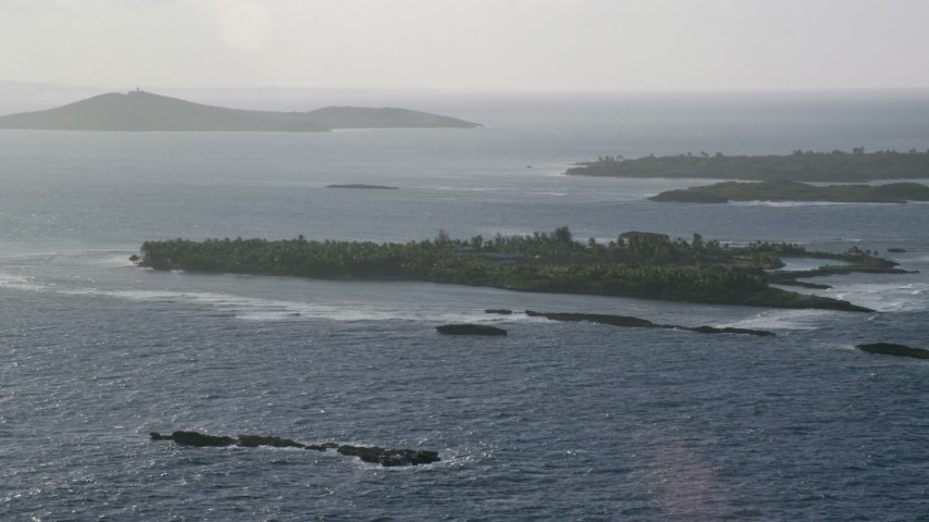 5k stock footage aerial video of a Small Caribbean island with vegetation and a home, Puerto Rico Aerial Stock Footage | AX103_113
