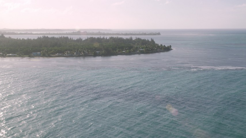 5k stock footage aerial video of Oceanfront Caribbean homes and trees on an island, Rio Grande, Puerto Rico Aerial Stock Footage | AX103_126