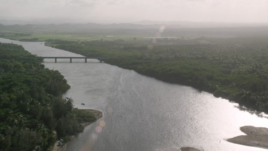5k stock footage aerial video of a Bridge over a river surrounded by vegetation, Loiza, Puerto Rico Aerial Stock Footage AX103_136 | Axiom Images