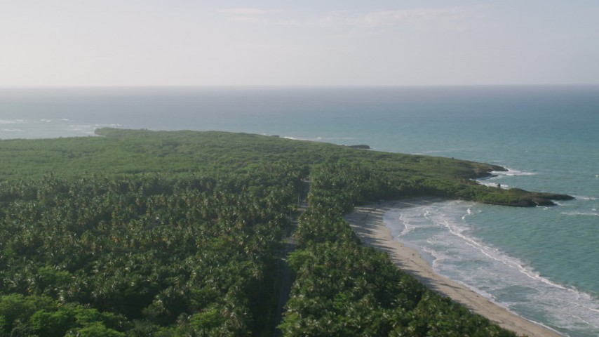 5k stock footage aerial video of Jungle along Caribbean blue waters, Loiza, Puerto Rico Aerial Stock Footage | AX103_137