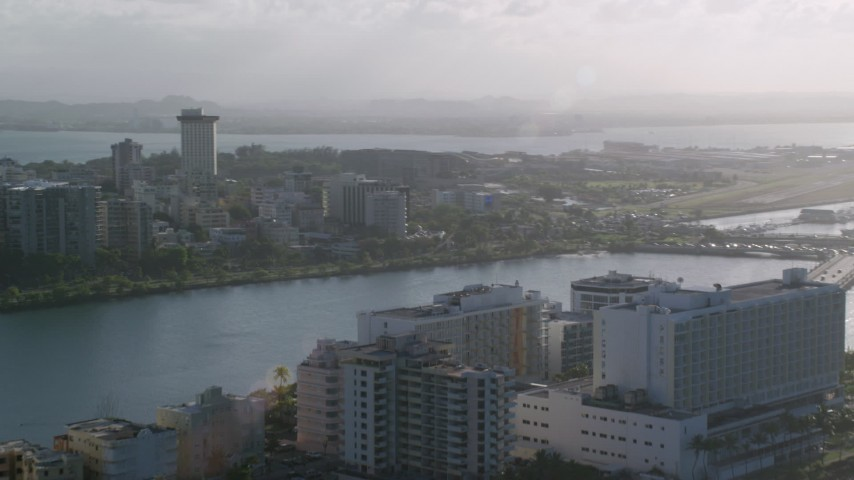 5k stock footage aerial video of Apartment buildings along Caribbean waters, San Juan, Puerto Rico Aerial Stock Footage | AX103_151