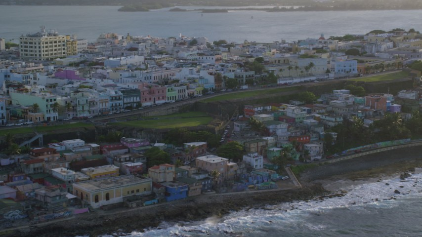 5k stock footage aerial video of Oceanfront Caribbean homes, Old San Juan, Puerto Rico, sunset Aerial Stock Footage | AX104_003