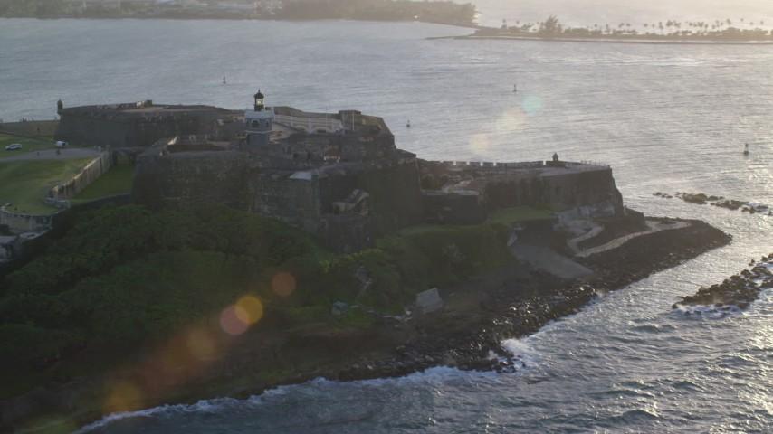 5k stock footage aerial video of Fort San Felipe del Morro, Old San Juan, sunset Aerial Stock Footage | AX104_004