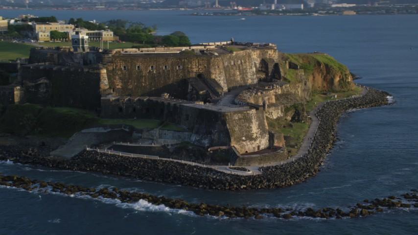 5k stock footage aerial video of Fort San Felipe del Morro, Old San Juan, sunset Aerial Stock Footage   AX104_005