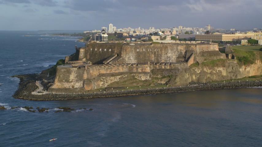 5k stock footage aerial video of Fort San Felipe del Morro, Old San Juan, sunset Aerial Stock Footage | AX104_006