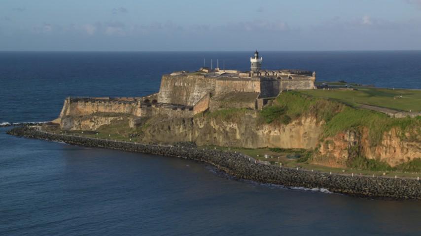 5k stock footage aerial video of Fort San Felipe del Morro, Old San Juan, sunset Aerial Stock Footage | AX104_008
