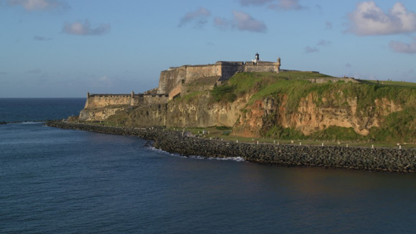 5k stock footage aerial video of Fort San Felipe del Morro, Old San Juan, sunset Aerial Stock Footage | AX104_010