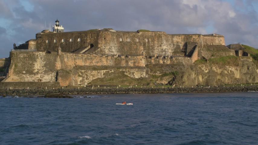 5k stock footage aerial video of Fort San Felipe del Morro, Old San Juan, sunset Aerial Stock Footage | AX104_016