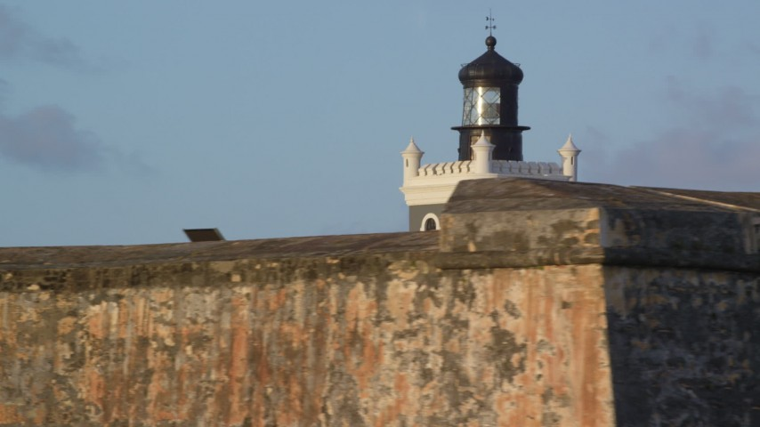 5k stock footage aerial video of Port San Juan Light and Fort San Felipe del Morro, Old San Juan, sunset Aerial Stock Footage | AX104_024