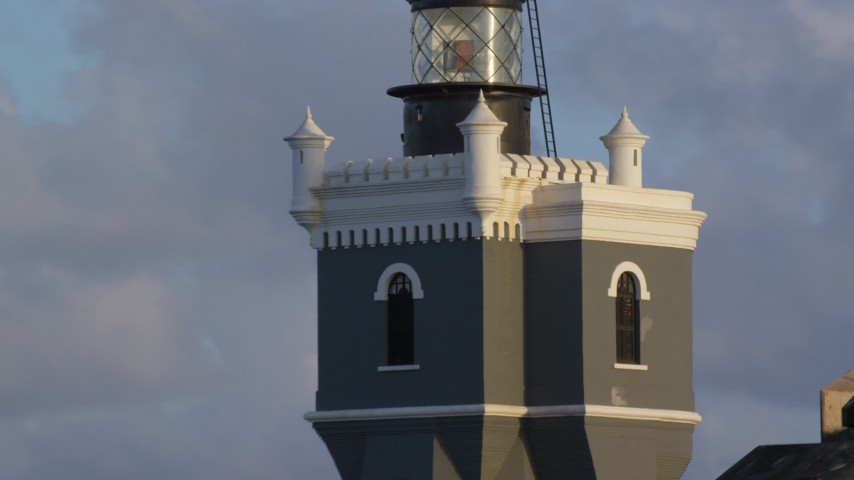 5k stock footage aerial video of Port San Juan Light atop Fort San Felipe del Morro, Old San Juan, sunset Aerial Stock Footage | AX104_026