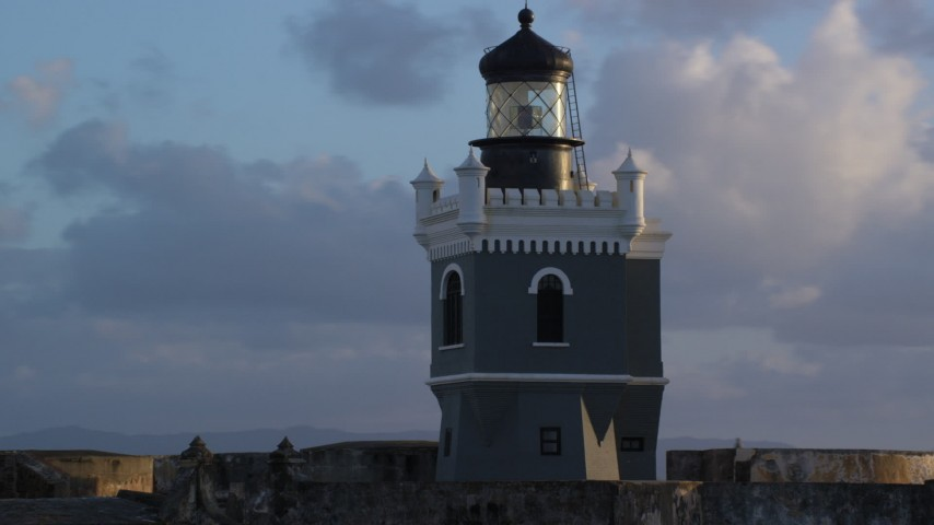 5k stock footage aerial video of Port San Juan Light atop Fort San Felipe del Morro, Old San Juan, sunset Aerial Stock Footage | AX104_027