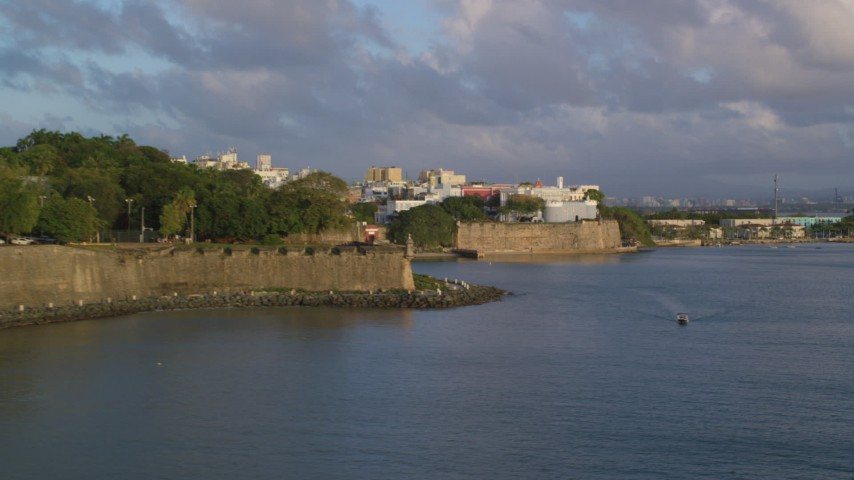 5K stock footage aerial video of La Fortaleza and calm ocean waters, Old San Juan sunset Aerial Stock Footage | AX104_031