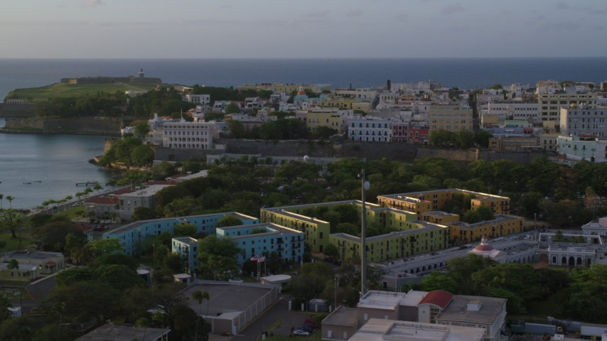 5K stock footage aerial video of La Fortaleza and Caribbean buildings, Old San Juan sunset Aerial Stock Footage | AX104_035