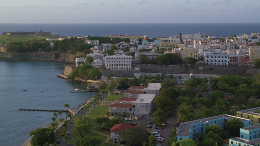 5k stock footage aerial video of La Fortaleza and Caribbean buildings, Old San Juan sunset Aerial Stock Footage | AX104_036
