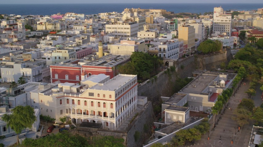 5k stock footage aerial video of La Fortaleza and neighboring buildings, Old San Juan sunset Aerial Stock Footage | AX104_039