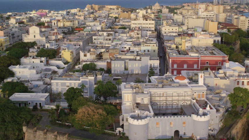 5K stock footage aerial video of La Fortaleza and surrounding buildings, Old San Juan sunset Aerial Stock Footage | AX104_040