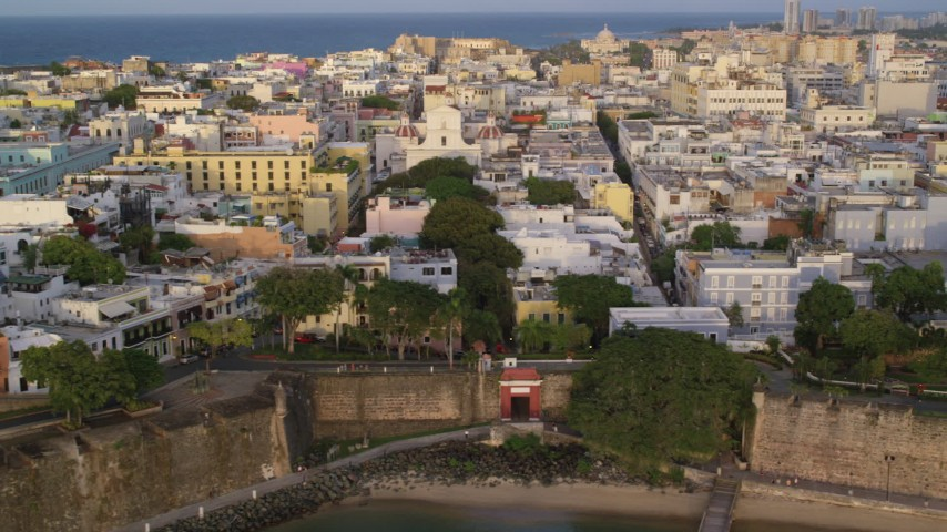 5k stock footage aerial video of a Caribbean neighborhood, Old San Juan, Puerto Rico sunset Aerial Stock Footage | AX104_041