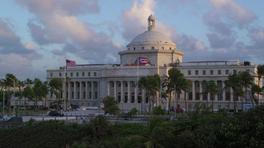 5k stock footage aerial video Flying over San Juan Capitol Building, Old San Juan Puerto Rico, sunset Aerial Stock Footage | AX104_047