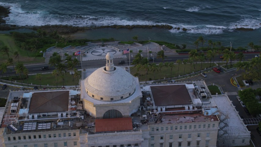 5k stock footage aerial video Circling San Juan Capitol Building, Old San Juan Puerto Rico, sunset Aerial Stock Footage | AX104_049